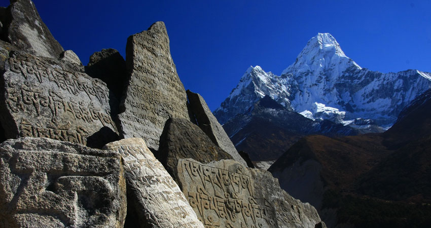 Buddhist tablets and amadablam in the background